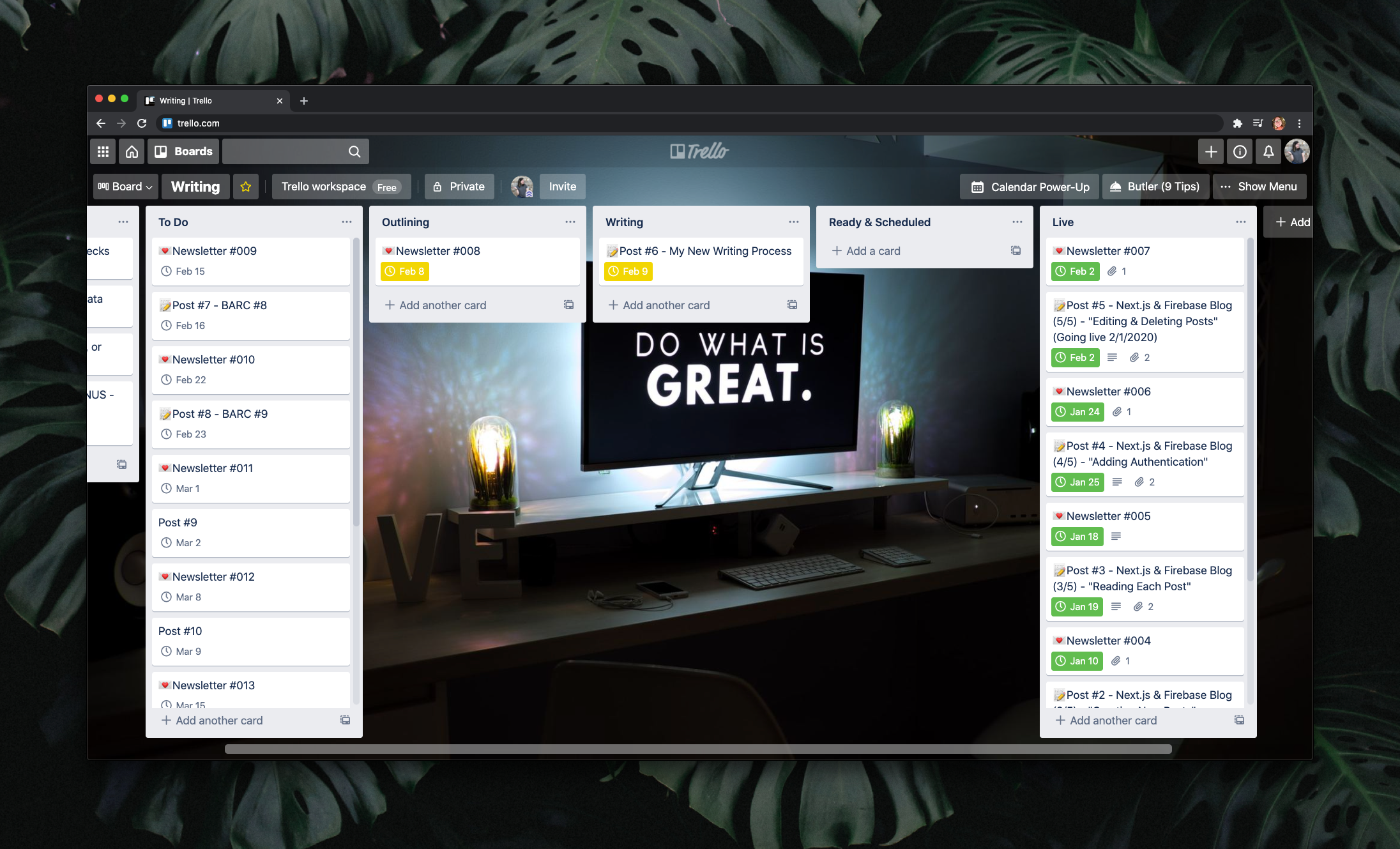 """Trello board showing 5 columns: To Do, Outlining, Writing, Ready & Scheduled, and Live. The background of the board is a desk in a dark room with a computer screen that reads """"Do what is great."""""""