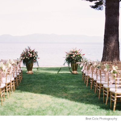 Floral arrangements at the front of the aisle