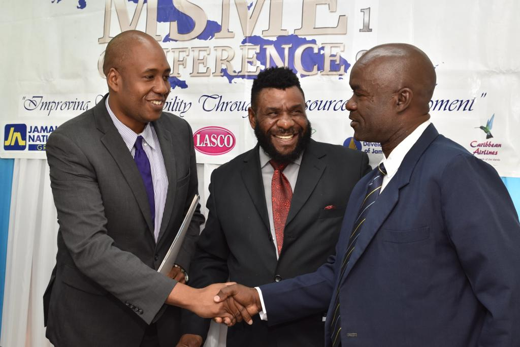 Mr. Ryan Parkes, Chief Banking Officer greeted by Mr Hugh Johnson, President of the SBAJ and Mr. Garnet Reid, Director