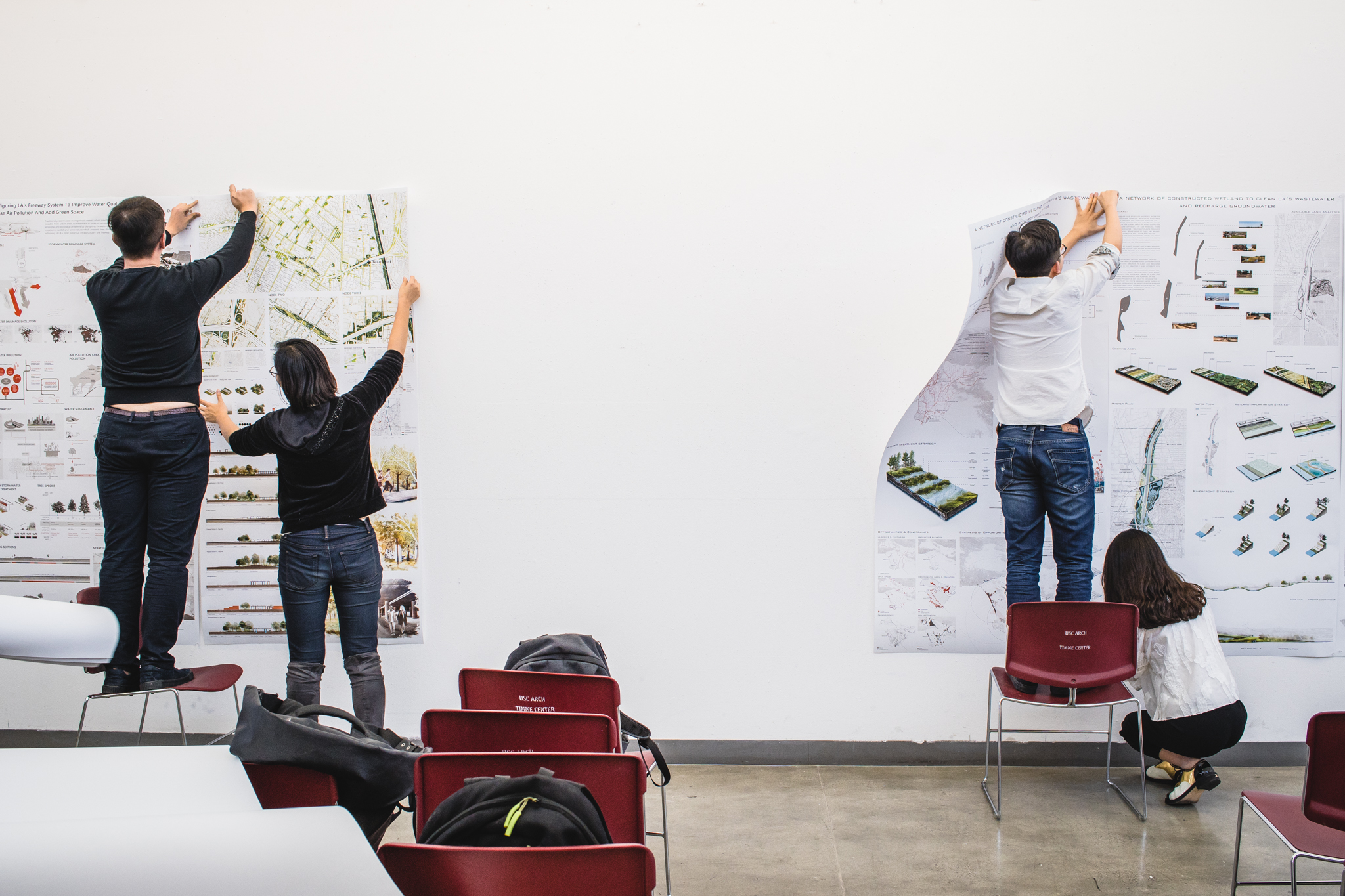 Students pin work for final reviews at the USC School of Architecture