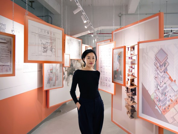"""Elaine Yolam Kwong with her """"Incremental Village"""" exhibit. Photos courtesy of Elaine Yolam Kwong."""