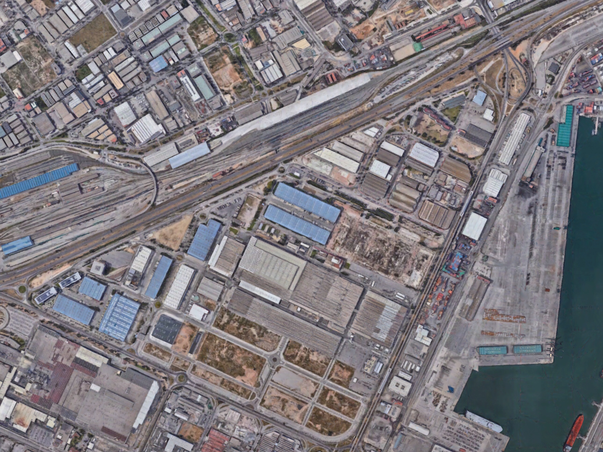 Aerial view of the Zona Franca, a massive logistics and industrial site that is targeted to become the next new residential part of Barcelona. This would fit 141 typical city example blocks.