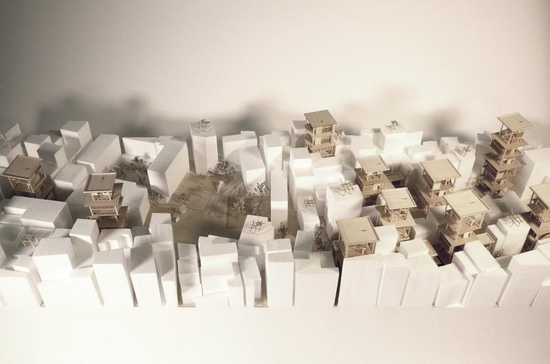 """Incremental Village"" exhibit physical model."
