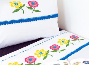 Jogo de cama com bordados