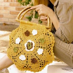 Bolsa mostarda de crochê com flores