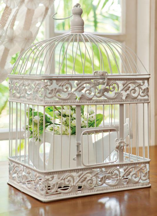 Arranjo feito com gaiola de pássaros