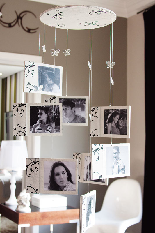 Móbile de fotos decorado com estêncil