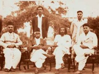The Early RSS Team From Left Appaji Joshi, Dr KB Hedgewar Guruji and Buban Rao Pandit at a meeting held at Sindi in 1938. Vithal Rao Patki and Balasaheb Deoras are also seen standing