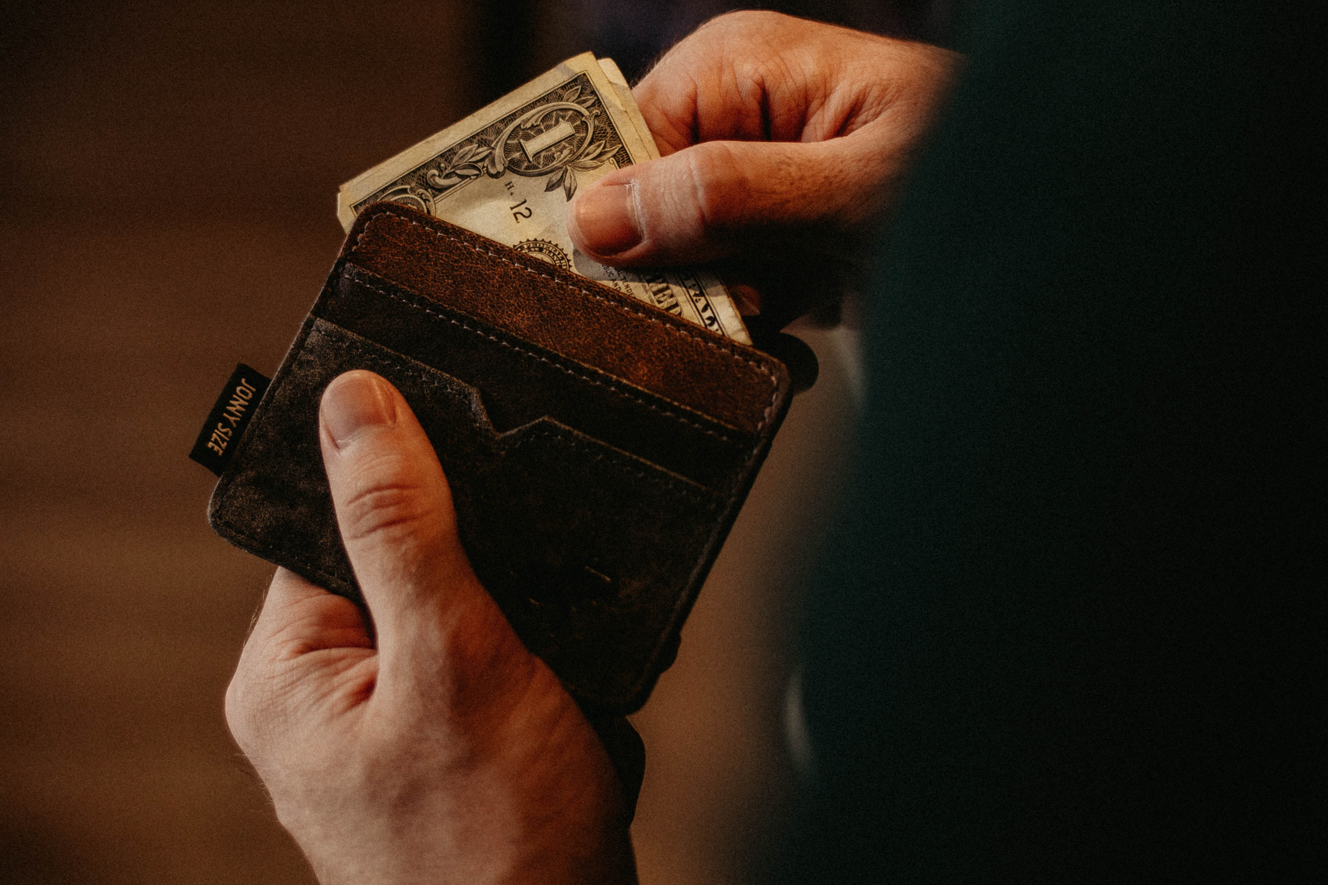 Person taking money out of his wallet.