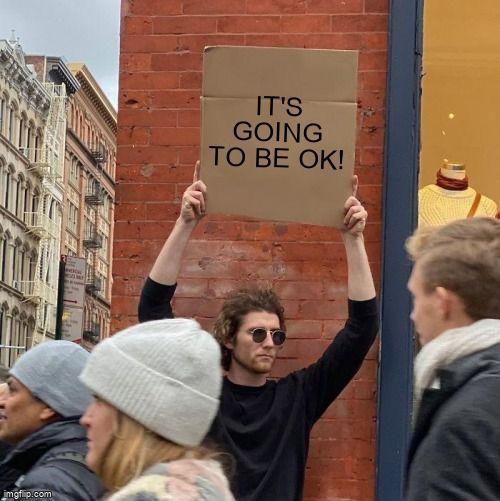 Guy Holding Cardboard Sign