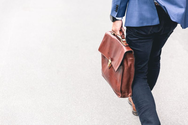 A person walking with a briefcase