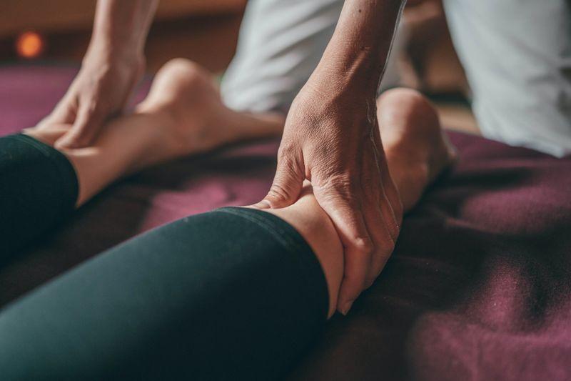 Hands massaging legs