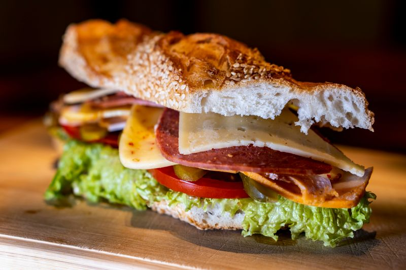 Sandwich with meat, cheese, and lettuce.