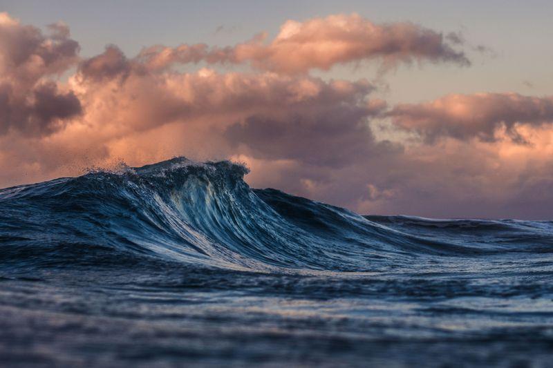 Ocean wave with cloudy skies