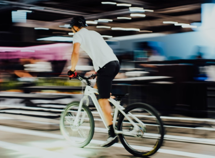 A person riding a hybrid bike through a city