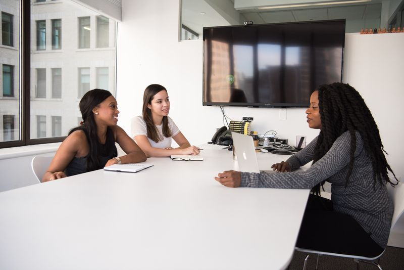 Three people in an interview