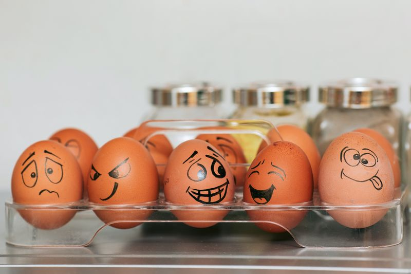 Picture of a variety of emotion faces drawn on eggs