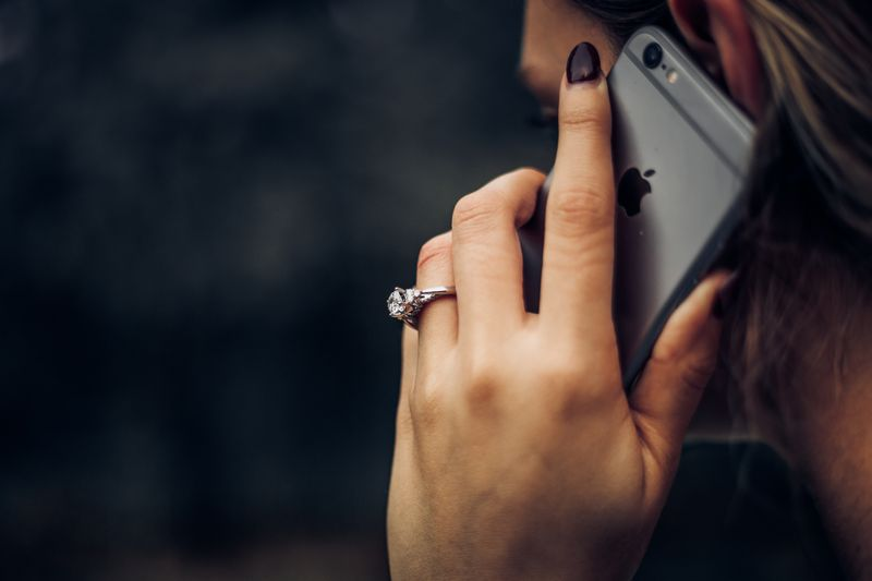 A woman holding a phone