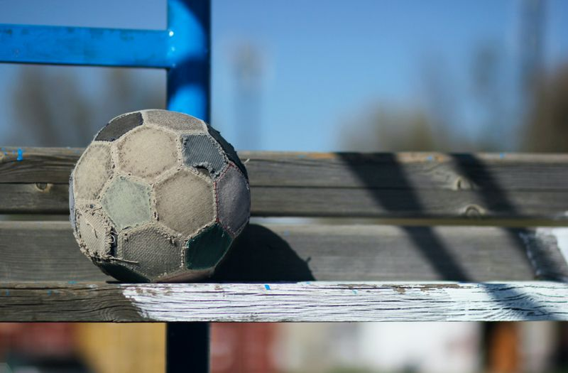 A football that has been well-played with.