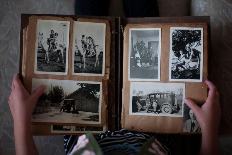 Person looking through a photo album.