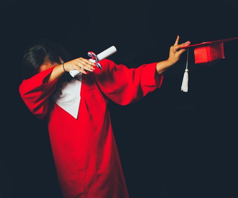 a high school student in graduation attire