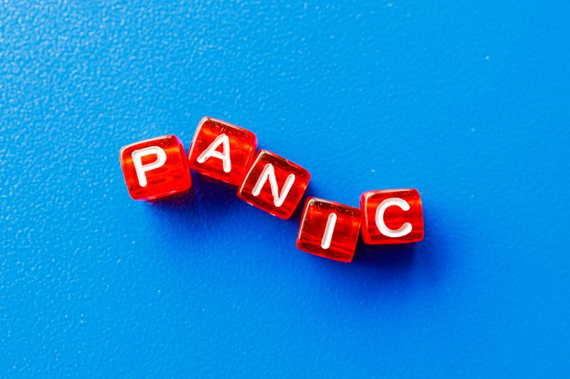 The word panic spelled out with red letter cubes