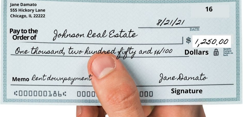 A check properly filled out and signed.