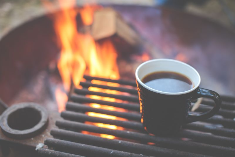 A great cup of coffee over a campfire (Photo by Alex Holt on Unsplash)