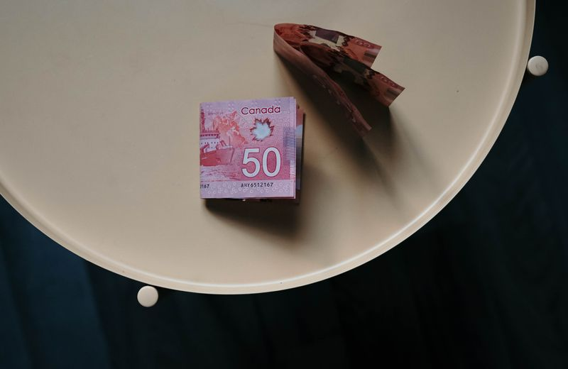 A few Canadian $50 bills on a table