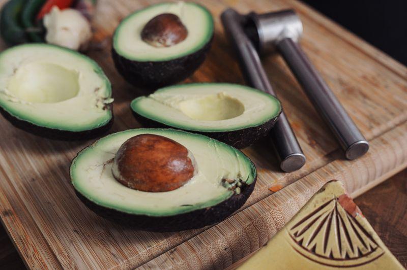 Fresh cut avocados (Photo by Conscious Design on Unsplash)