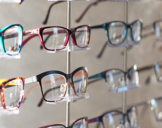 Glasses on a wall display in a store