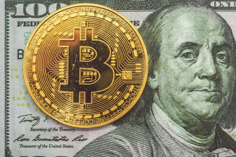 Bitcoin on a usd 100 dollar bill