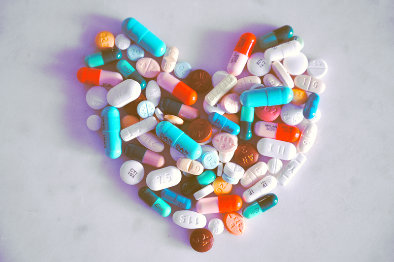 colourful pills in the shape of a heart