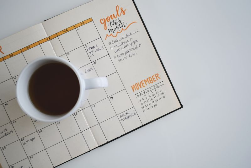 A coffee mug on a schedule diary