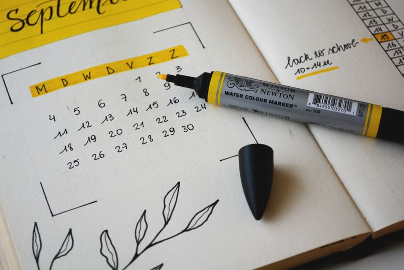 planner and yellow highlighter
