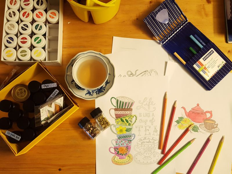 An example of a coloring station, with pencil crayons and coloring pages
