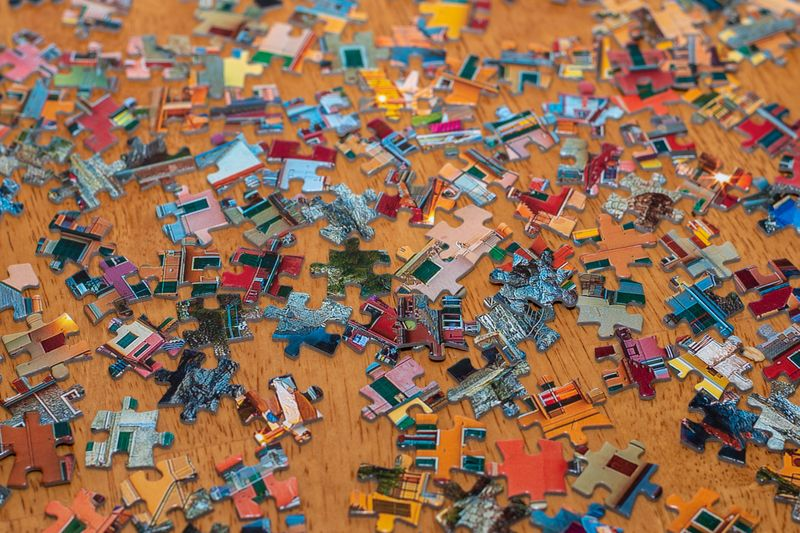 Jigsaw puzzle pieces scattered on a table