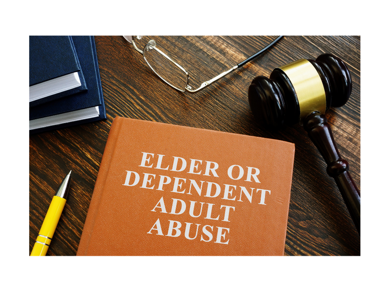 A book titled Elder or Dependent Adult Abuse on a table with a gavel, pen, additional books, and eyeglases.