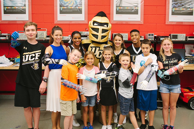 A group picture of the Bionic Kids with Knightro and UCF cheerleaders