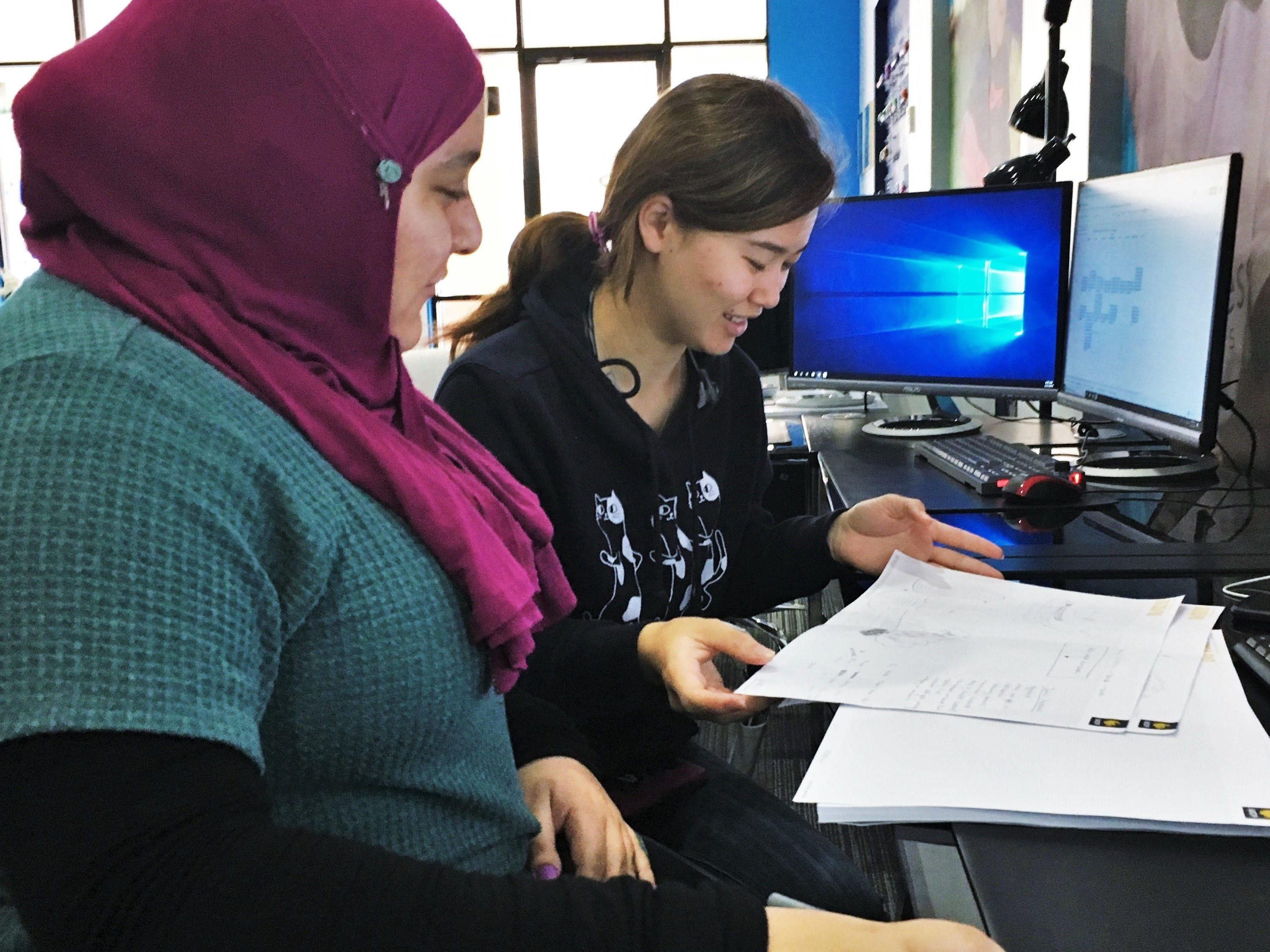 Two of our Limbitless scholars, Basma and Julia, brainstorming ideas for one of their engineering projects.