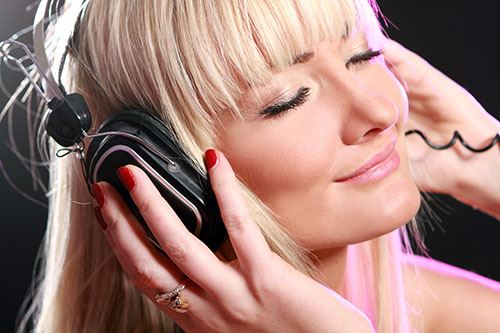 A girl listening to loud music