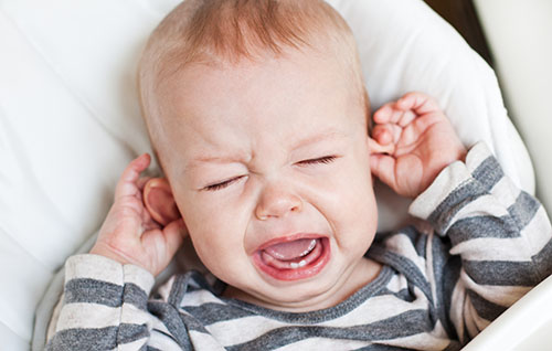 ENT problems in the kids, crying kid holding the ear, ENT specialist