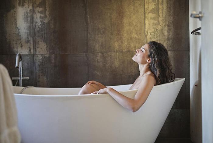 portraying a girl taking a sitz bath