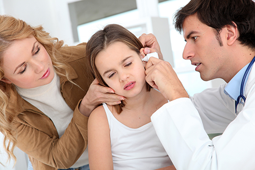 an ENT specialist diagnosing the ear infection