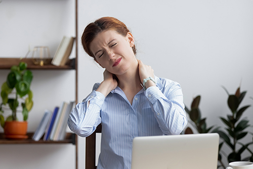 Image of office employee suffering from neck pain