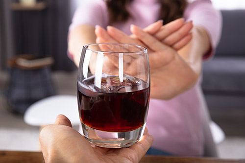 woman saying no to alcohol