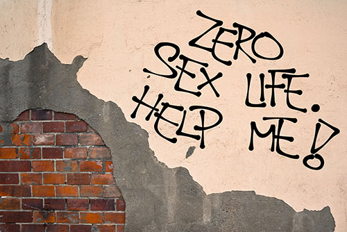"""zero sex life. help me!"" written on wall"