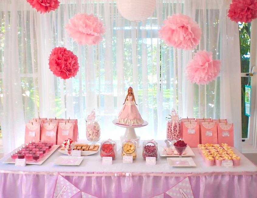 Pink Princess dessert table with Barbie cake