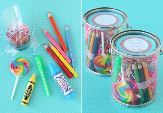 Colored pencils, crayons and candy inside a party favor jar