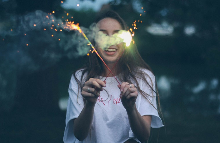 Girl holding sparklers on 4th of July